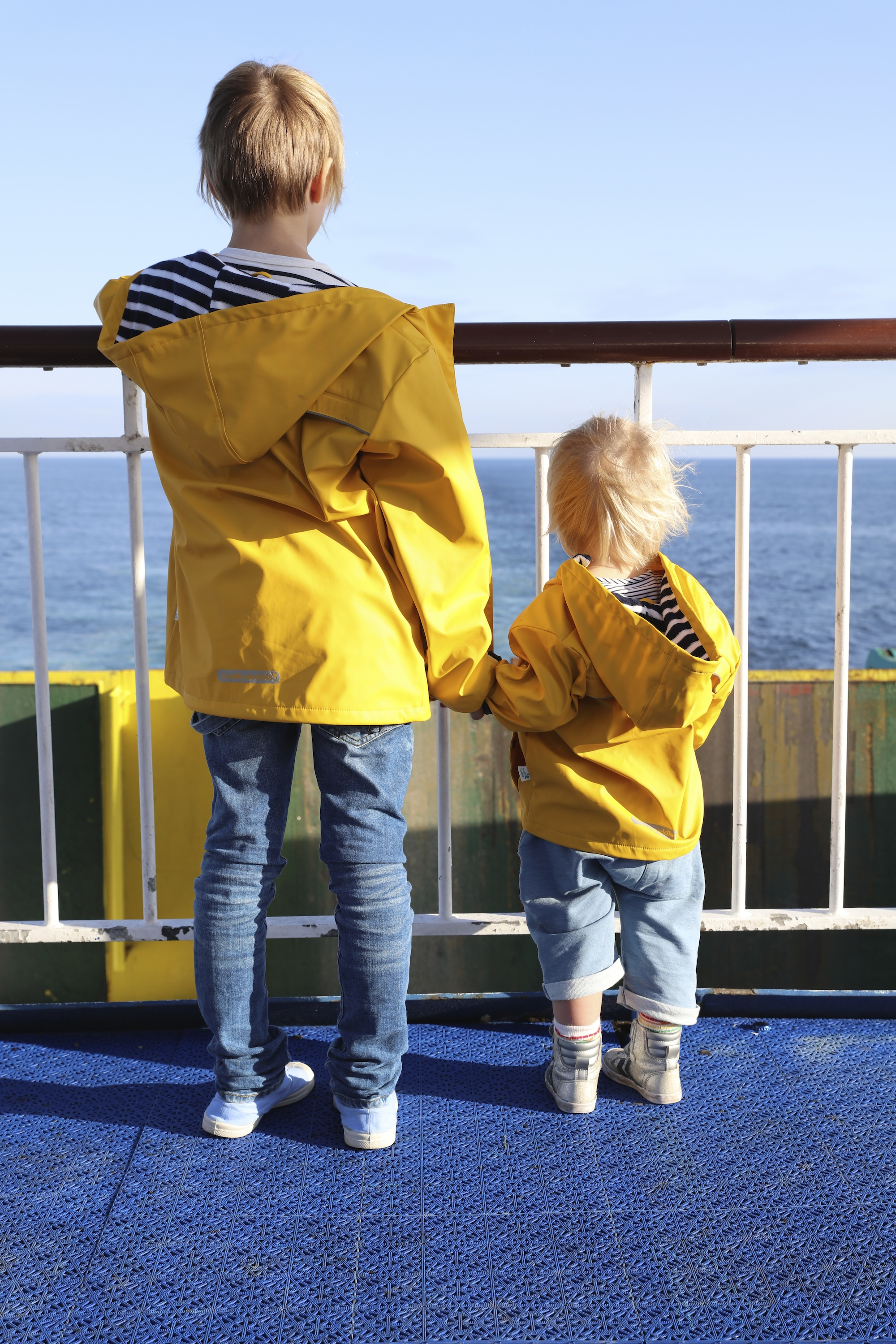 Muddy_pudles_yellow_raincoat_mac_unisex
