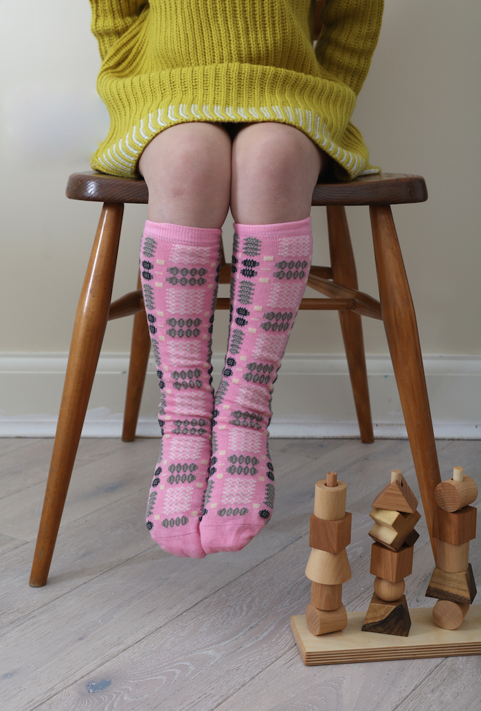mabli_knits_socks_pink_ercol_chair_decade_of_designs